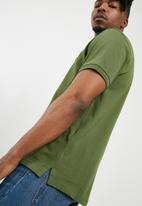 Levi's® - Ama housemark polo