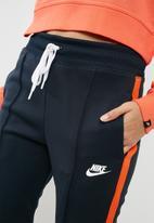 b8a78041d534 Stripe pants - navy   orange Nike Bottoms