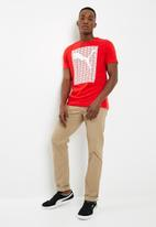 PUMA - Puma repeat tee - red