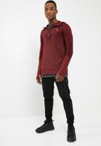 PUMA - Evoknit energy half zip - maroon & black