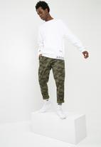 7b4062678bd40 NMD Crew Sweater - White adidas Originals Hoodies