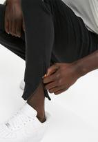 basicthread - Piping retro joggers - black