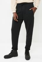 PUMA - Archive fashion pants - black