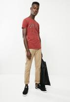 S.P.C.C. - High density graphic printed tee - red