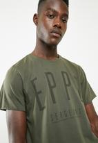 S.P.C.C. - Raw edge printed tee - green