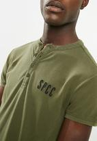 S.P.C.C. - Overdyed pique golfer - green