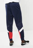 PUMA - Mcs track pants peacoat - blue & red