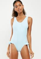 Missguided - Low side ruffle leg swimsuit - blue