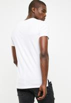 S.P.C.C. - Raw edge crew neck tee with print & applique - white