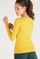 Supré  - Longsleeve longline deep v-neck - yellow