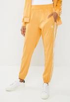 adidas Originals - Regular TP cuffed pants - orange