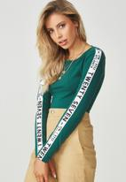Supré  - Sport tape bodysuit - green