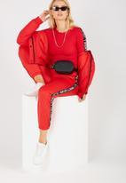 Supré  - Sport tape bodysuit - red