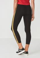 Supré  - Graphic legging - black & yellow