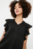 Vero Moda - Violet short sleeve flounce top - black