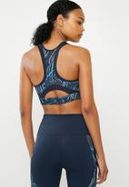 Nike - Swoosh feather curve sports bra - navy & blue