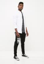 basicthread - Skinny sweat printed pants - black