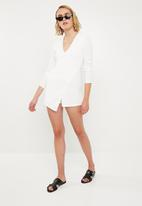 Missguided - Long sleeve crepe wrap skort playsuit - white