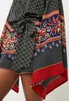 Missguided - Flared sleeve mixed print playsuit - multi