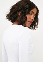 d8cb6eb26 Missguided - Button front long sleeve crop top - white. Click to enlarge