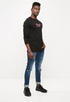 Superbalist - Skinny knee rip & side stripe jeans - mid wash