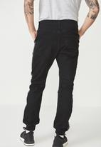 Cotton On - Slim fit ripped denim jogger - black