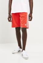 adidas Originals - Three stripe shorts - orange
