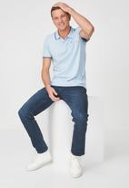 Cotton On - Icon short sleeve polo - blue