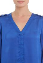 edit - Gold-trim blouse in blue