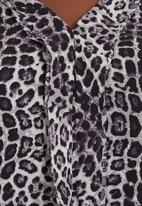 Megalo - Top with front frill Animal Print