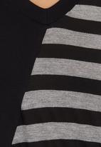 FRIENDS - Asymmetrical knit top