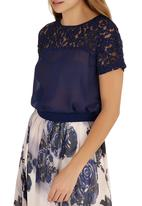 Girls on Film - Floral Lace Bow Back Top Navy
