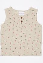 POP CANDY - Sleeveless Vest with Button Detail Milk