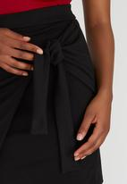 c(inch) - Cross Over Mini Skirt Black