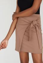 c(inch) - Cross Over Mini Skirt Camel