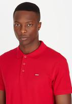 Levi's® - AMA Housemark Polo - Crimson