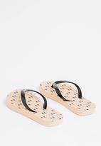 POP CANDY - Printed flip flops - beige & black