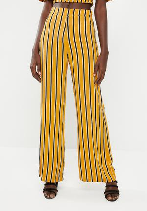 Wide leg pants - mustard & black