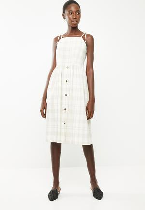 19fb0e9cac6 Check sun dress with button front detail - beige