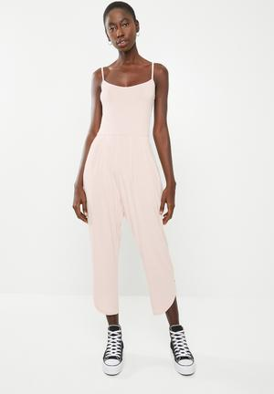 9eda280a30c3 Strappy yoga jumpsuit with pockets at the hip - pink