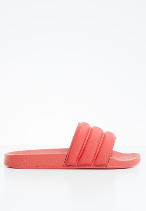 Evie sandal - white. By Superbalist R149 · Puff pool slide - coral d938aa481aea