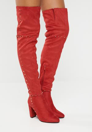 8212e4c11cb Studded thigh high boot - red
