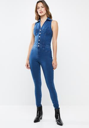 84b6cebba58f Sleeveless 4 way knit denim jumpsuit - dark blue