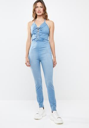 1065dcd309f8 Denim jumpsuit with criss cross detail - blue