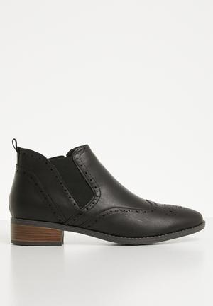 b70b4a8a52d6 Slip on brogue flat boot - black