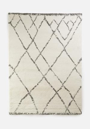 Royal nomadic shaggy rug - cream triangles