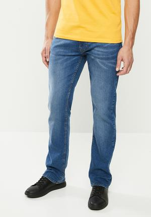 Slim straight jeans - mid washed blue