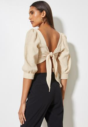 Textured cross over front puff sleeve crop with tie back - stone