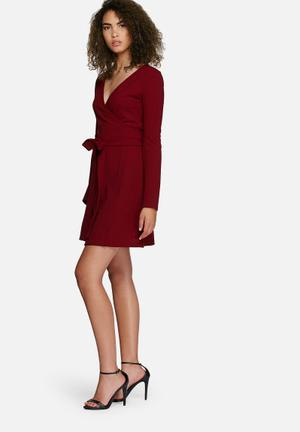 Fluted sleeve wrap dress