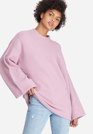 Oversized trumpet sleeve knit